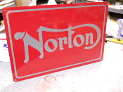 Norton Motorcycle Sign Silver on Red