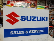 Suzuki Motorcycle Sales and Service Sign